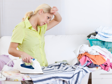 woman-ironing-and-looking-stressed